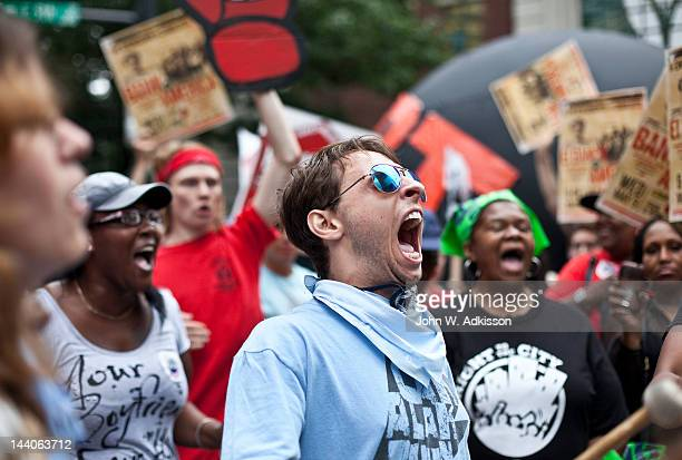 An activist shouts while protesting outside of the annual Bank of America Corp shareholders meeting on May 9 2012 in Charlotte North Carolina...