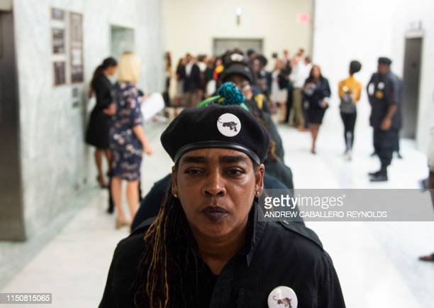 An activist stands in a line waiting to enter a hearing about reparation for the descendants of slaves, before the House Judiciary Subcommittee on...