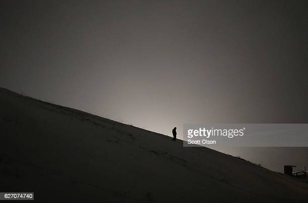 An activist stands on a hill outside Oceti Sakowin Camp on the edge of the Standing Rock Sioux Reservation on December 1, 2016 near Cannon Ball,...