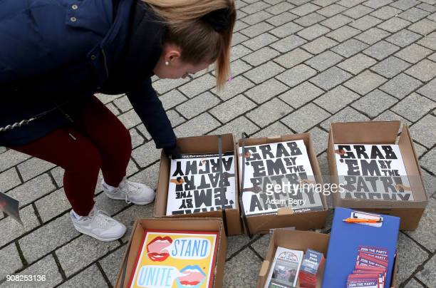 An activist takes a poster as she participates in a demonstration for women's rights on January 21 2018 in Berlin Germany The 2018 Women's March is a...