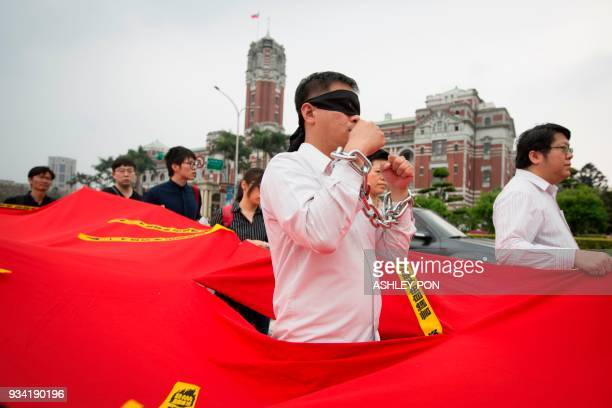 An activist takes part during the Commemorating Lee MingChes One Year Of Imprisonment Protest March in Taipei on March 19 2018 Taiwanese human rights...