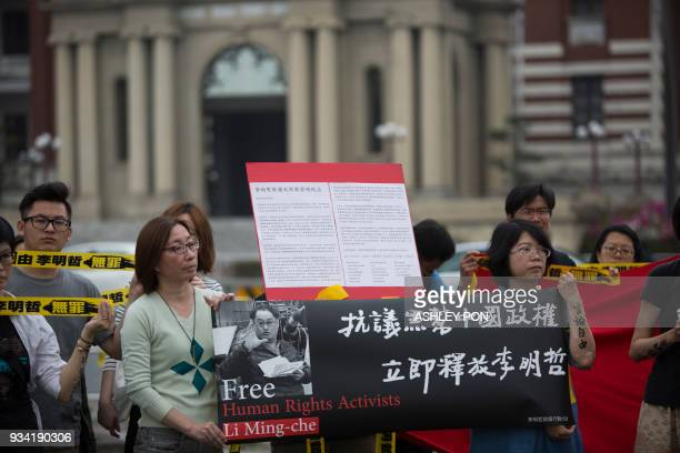 An activist takes part during the Commemorating Lee Ming-Ches One Year Of Imprisonment Protest March in Taipei on March 19, 2018. Taiwanese human...