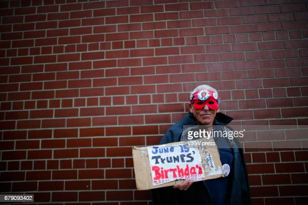 An activist takes part in a protest near the USS Intrepid where US president Trump is hosting the visit of Australian Prime Minister Malcolm Turnbull...