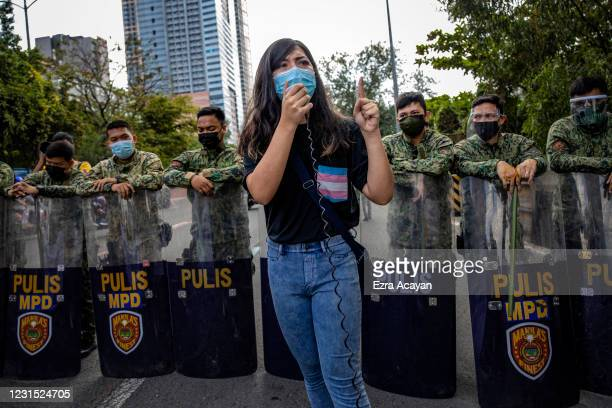 An activist takes part in a protest versus the decades-old Visiting Forces Agreement and continued US military presence in the country, at the US...