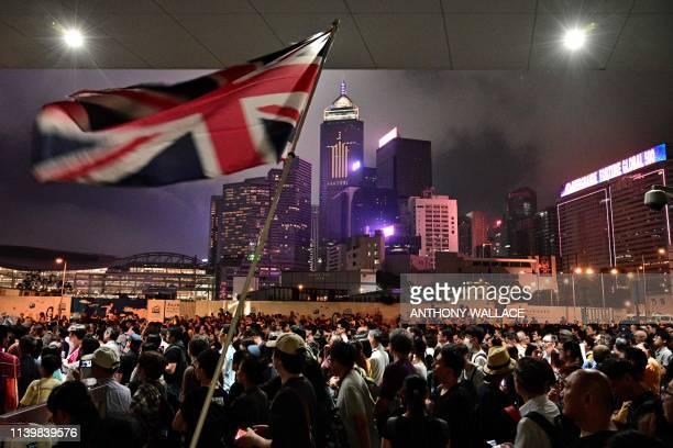 An activist waves a British Union Jack flag during a protest in Hong Kong on April 28 against a controversial move by the government to allow...