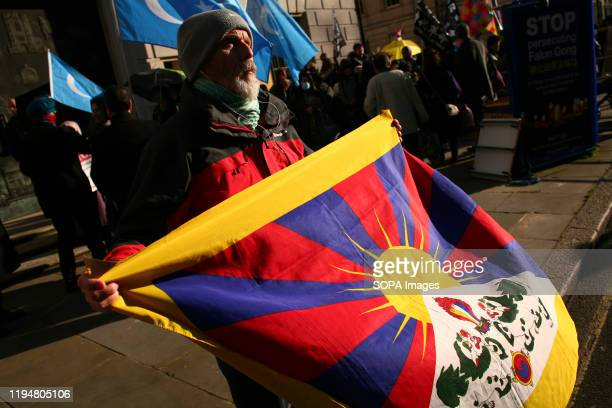 An activist waves a flag of Tibet during the protest Activists rally in solidarity with the prodemocracy movement in Hong Kong and in protest at...