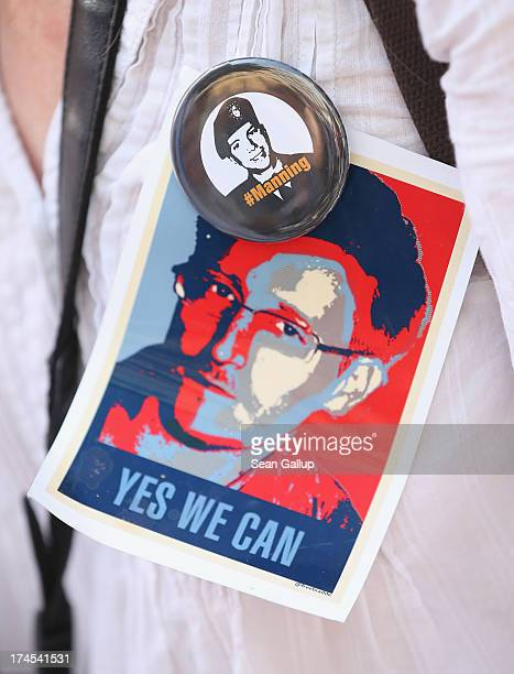 An activist wears pictures of whistleblowers Edward Snowden and Bradley Manning during a demonstration against the electonic surveillance tactics of...