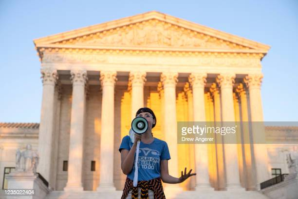 An activist, who declined to provide her name, speaks outside the Supreme Court in protest against the new Texas abortion law that prohibits the...