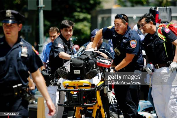 An activist whom took part in the March Against Sharia is attended by NYPD officer as he suffers a medical emergency during the rally on June 10 2017...