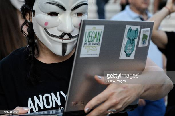 An activist with an anonymous face mask during a demonstration by vegan activists for the 'voiceless' on Syntagma Square