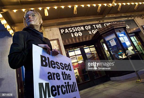 An activist with People for the Ethical Treatment of Animals protests at the Avalon Theater during the premiere of Mel Gibson's The Passion of the...