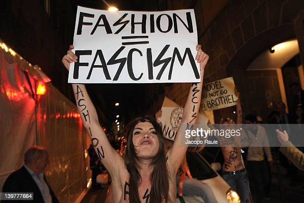 An activist with the feminist movement FEMEN protests during the Milan Womenswear Fashion Week on February 24 2012 in Milan Italy FEMEN is a...