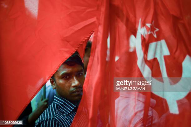 An activists from a Bangladeshi garments organization hold a rally in Dhaka on September 14 to demand a mandatory monthly minimum wage Several...