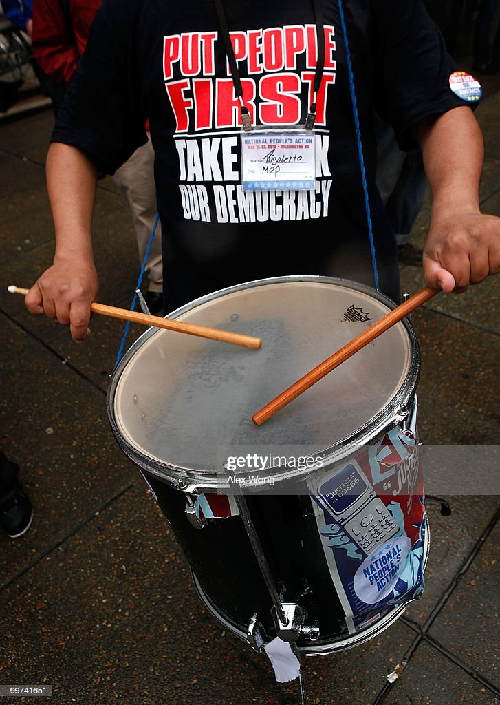 An activists hits a drum as he protests to call for Wall Street reform and bank accountability May 17, 2010 in front of a Bank of America in Washington, DC. The march, held by National People�s Action, SEIU, the AFL-CIO, and Jobs with Justice, was part of the three-day 'Reclaim our Democracy 2010' conference organized by National People�s Action.