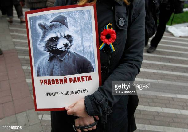 An Activists of political movement ''Democratic ax'' seen holding a portrait of Marvel comics characters during the victory Day Immortal Regiment...