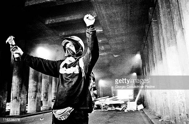 An activists of the antiglobalization movement shows a molotov cocktail during a protest against the 27th G8 Summit In Genoa on July 21 2001 in Genoa...