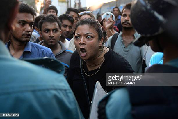 An activists reacts as Bangladesh police stop Facebook activists as they march to protest a ban on rickshaw pullers wearing 'lungi' traditional men's...