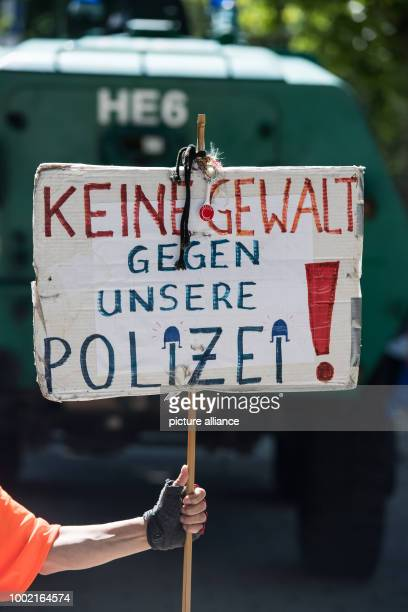 An activists speaks up for the protection of police officers with a sign in Frankfurt am Main Germany 24 June 2017 Photo Andreas Arnold/dpa