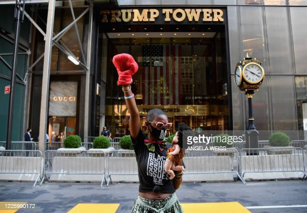 An activists stands near a newly painted Black Lives Matter mural outside of Trump Tower on Fifth Avenue on July 9, 2020 in New York City.
