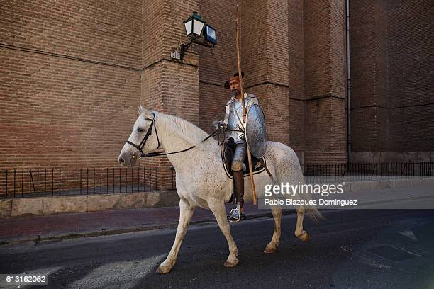 An actor depicting Don Quijote de la Mancha rides a horse along the streets during the Cervante's Week on October 7 2016 in Alcala de Henares Spain...