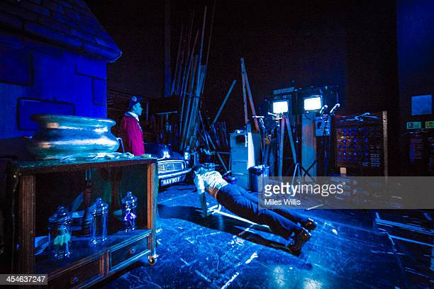 An actor does pressups prior to going onstage during the Puss in Boots pantomime at the Hackney Empire on December 6 2013 in London England
