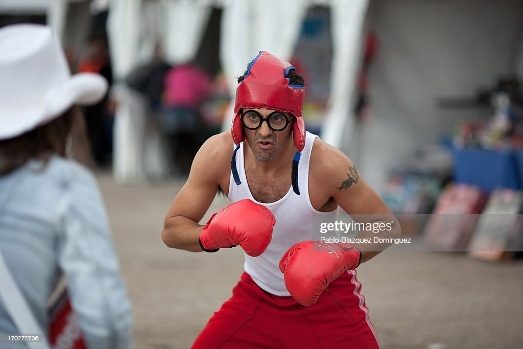 An actor dressed as a boxer performs at the Jarama Circuit on June 9, 2013 in Madrid, Spain. The Jarama Vintage Festival seeks to revive the 1960s, 70s and 80s attracting classic cars and motorbikes against a background of public orientated activities and shows.