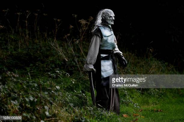 An actor dressed as a White Walker character from the Game of Thrones series waits to pounce on unsuspecting fans as the Winterfell Festival takes...