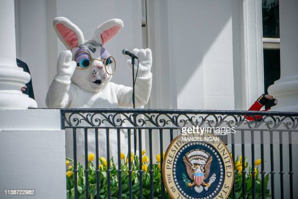 An actor dressed as an Easter Bunny adresses the crowd before US President Donald Trump and First Lady Melania Trump take part in the annual White...