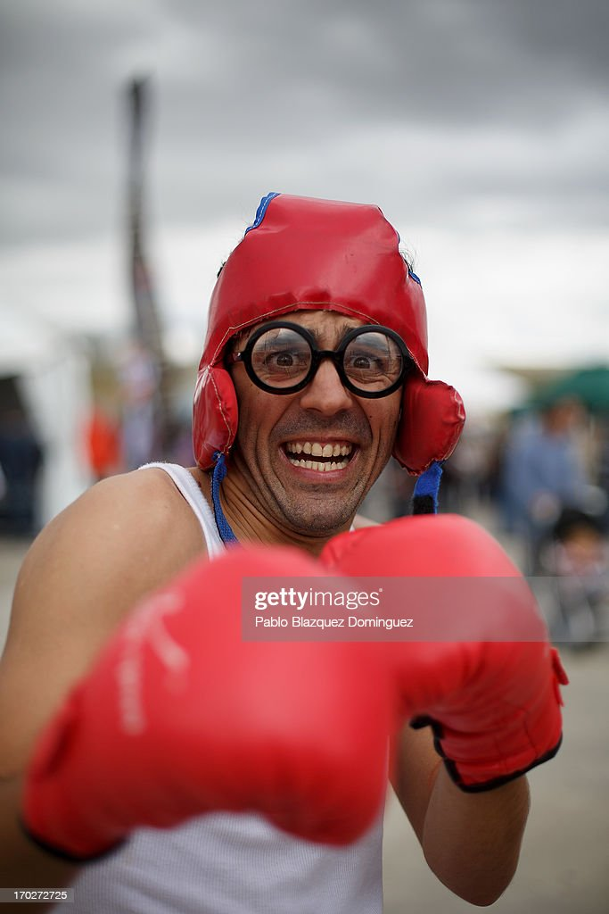 An actor dressed as boxer poses for a picture at the Jarama Circuit on June 9, 2013 in Madrid, Spain. The Jarama Vintage Festival seeks to revive the 1960s, 70s and 80s attracting classic cars and motorbikes against a background of public orientated activities and shows.