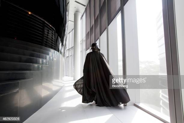 An actor dressed as Darth Vader a Star Wars character poses for a photograph during the opening ceremony for Lucasfilm Ltd's Sandcrawler building...