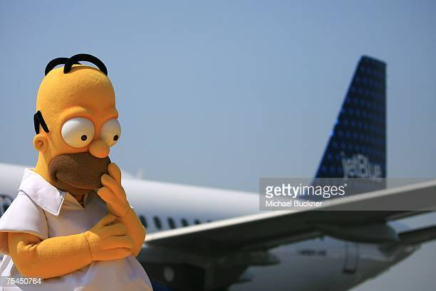 An actor dressed as Homer Simpson from the longrunning televsion cartoon series The Simpsons attends the unveiling of Jet Blue's Simpson's themed...