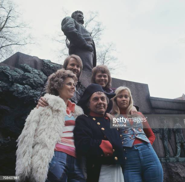 An actor dressed as Napoleon Bonaparte poses with Swedish pop group Abba to promote their single 'Waterloo' in Copenhagen Denmark in 1974 Clockwise...