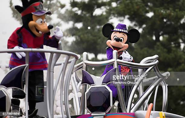 An actor dressed as the character Mickey Mouse right performs during the Disney's Halloween 2016 event at Tokyo Disneyland on on October 25 2016 in...
