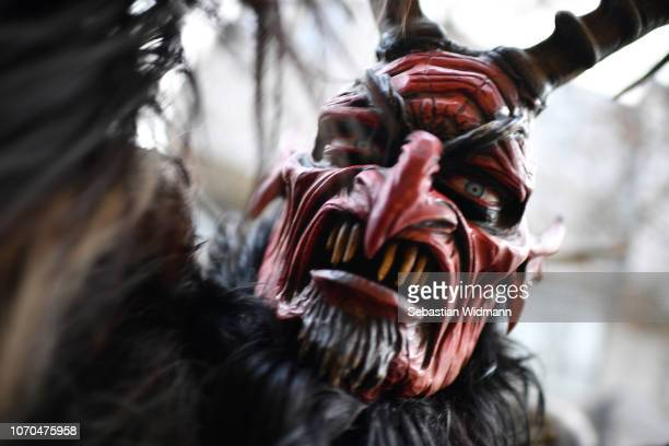An actor dressed as the Krampus creature parades through the city center's pedestrian shopping district on December 9 2018 in Munich Germany Krampus...
