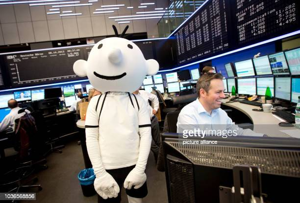 An actor dressed as the main protagonist of the book series 'Diary of a wimpy Kid', Gregory 'Greg' Heffley, is pictured at the stock exchange shortly...
