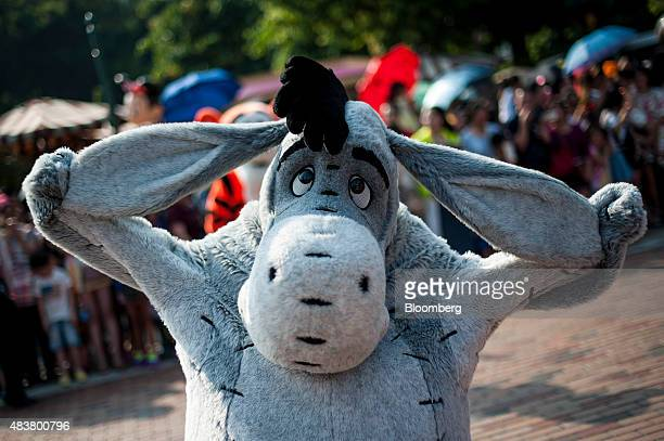 An actor dressed in am Eeyore costume performs during a parade at the company's Disneyland Resort in Hong Kong China on Friday Aug 7 2015 Hong Kong...