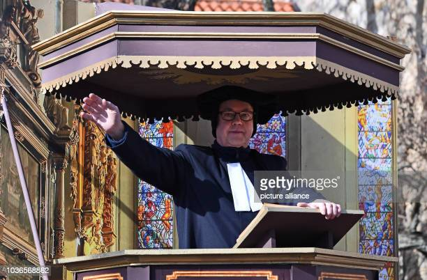 An actor dressed up as Luther reads out a sermon in the Georgenkirche during the traditional spring festival parade in Eisenach Germany 25 March 2017...