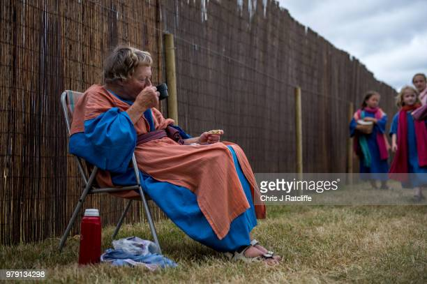 An actor drinks tea and eats a hot cross bun before beginning a production of 'The Life of Christ' by the Wintershall Estate on June 19 2018 in...