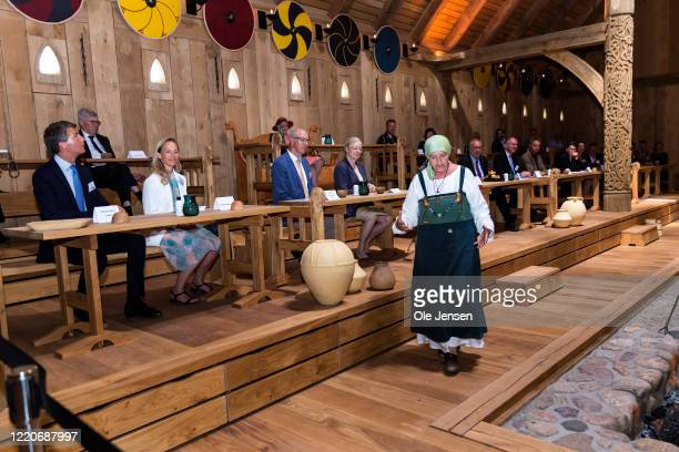 """An actor entertain the Queen and other guests by citing a Viking saga during the opening ceremony for the Kings Viking Hall at the """"Land of Legends""""..."""