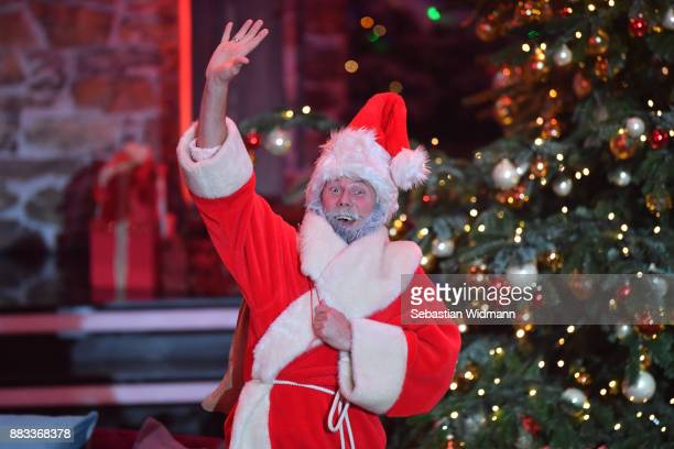 An actor in a Santa Claus costume gestures during the tv show 'Heiligabend mit Carmen Nebel' on November 29 2017 in Munich Germany The show will be...