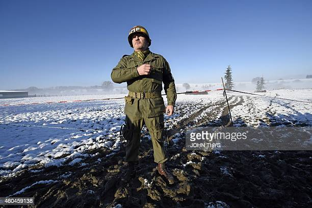 An actor in period US uniform takes part in the reanactment of the 70th anniversary of the Battle of the Ardennes also known as the Ardennes...