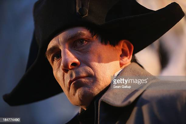 An actor in the role of Napoleon Bonaparte watches the arrival of a Saxon Guard at the evening opening ceremony to commemorate the 200th anniversary...