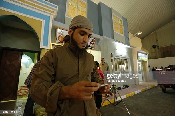 An actor is seen on the set of the television series whose title is loosely translated as 'State of Superstition' during filming in the Iraqi capital...