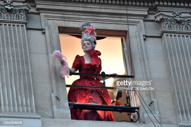 An actor of the Comedie Francaise with costume performs on a balcony of the Comedie Francaise to protest against the pension reform on March 1 2020...