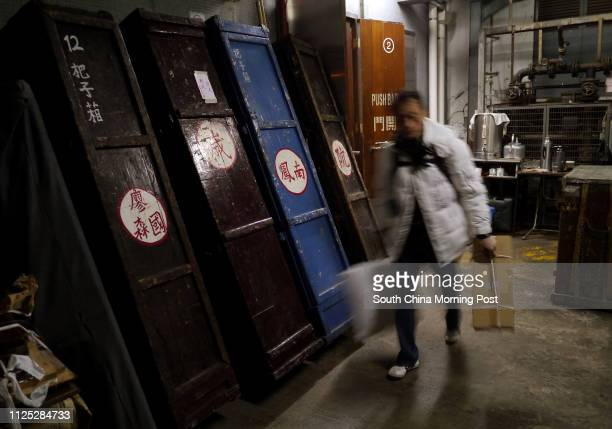 An actor passes by Feng Sheng Hui Theatre's costume box outside the Sunbeam Theatre after their last show Sunbeam Theatre where Feng Sheng Hui...