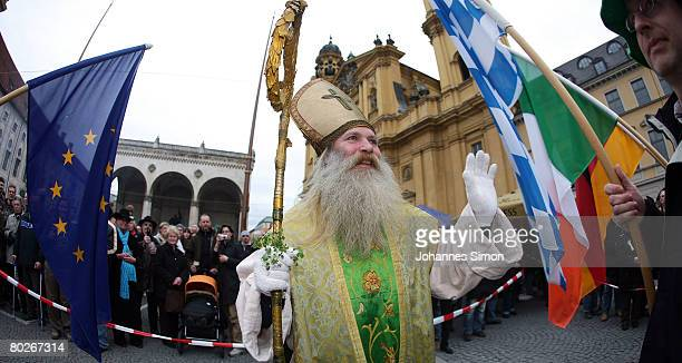 An actor performing the Irish national Saint St Patrick arrives at Odeonsplatz Square during the StPatrick's Parade on March 16 2008 in Munich...