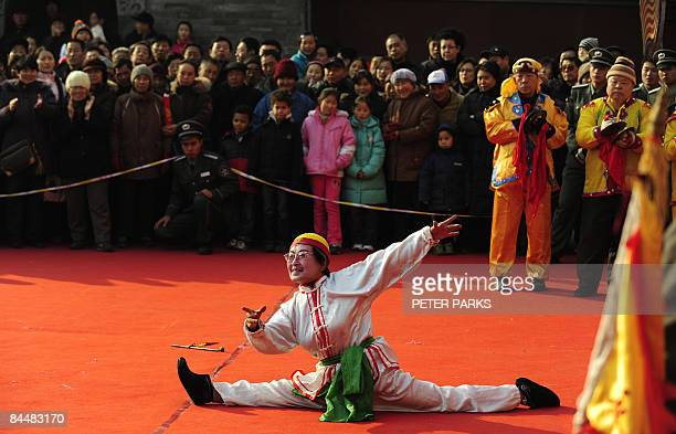 An actor performs at a temple fair on the second day of the Chinese Lunar New Year in Beijing on January 27 2009 Tens of millions of people across...
