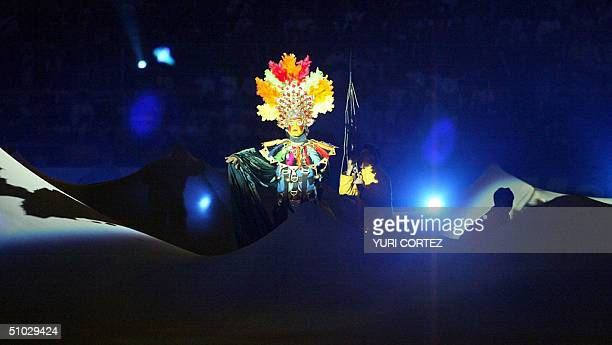 An actor playing as a mythical PanAndean character performs 06 July 2004 at the Nacional stadium in Lima during the opening ceremony of the Copa...