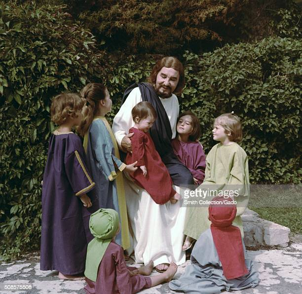 An actor playing Jesus is surrounded by children taking part in the Black Hills Passion Play which ended a 70 year run in 2008 Spearfish South Dakota...