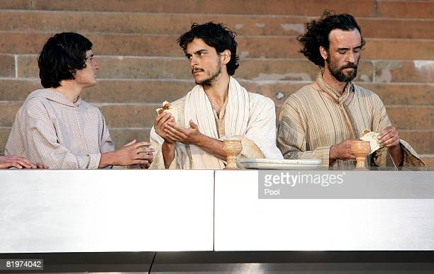 An actor playing Jesus passes bread at the last supper during the The Stations of the Cross outside St Mary's Cathedral in Sydney Friday July 18...